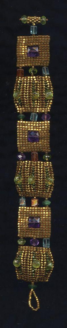 Klimt Bracelet by Jeka Lambert.   Seed bead woven.  24K gold plated seed beads, amethyst, peridot, hessonite garnet, adventurine, apatite, cubic zirconia.