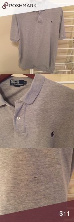 Men's Gray polo by Ralph Lauren polo shirt size XL Gray polo by Ralph Lauren polo shirt. Size XL. Small pinhole toward the bottom of the shirt. Hard to notice. Otherwise in good condition. Polo by Ralph Lauren Shirts Polos