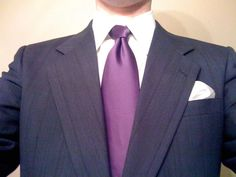 Simple black/dark gray suits with solid purple ties (probably plum color) for the groom and his groomsmen