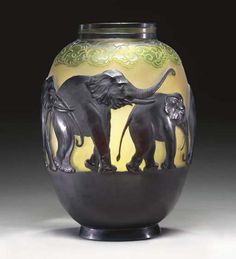 A MOLD-BLOWN, OVERLAID AND ETCHED GLASS 'ELEPHANT' VASE EMILE GALLE, CIRCA 1924 15in. (38.1cm.) high intaglio signature Gallé