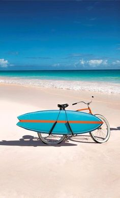 Fish surfboard on a bike at the beach