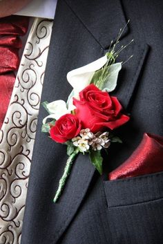 The Groom's Boutonniere consisted of a luscious Red Rose, a Crystal Blush Calla Lily, Blossom and Dendrobium Orchid with a flourish of Champagne Grass Red Rose Bouquet, Red Bouquet Wedding, Corsage Wedding, Rose Wedding, Prom Bouquet, Calla Lily Boutonniere, Prom Corsage And Boutonniere, Groom Boutonniere, Red Corsages