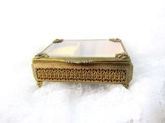 Early Jewelry / Vanity Music Box  What a beautiful find this piece is. It is a 1960s beautiful metal engraved jewelry box in exceptional