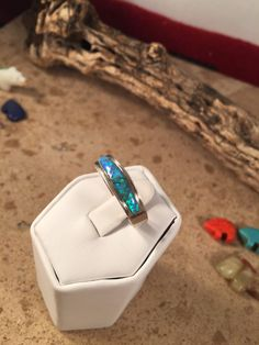 A personal favorite from my Etsy shop https://www.etsy.com/listing/267410622/blue-fire-opal-sterling-silver-navajo