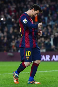 Lionel Messi of FC Barcelona celebrates after scoring his team's fourth goal from the penalty spot during the La Liga match between FC Barcelona and Levante UD at Camp Nou on February 15, 2015 in Barcelona, Catalonia.