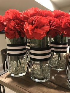 Graduation party centerpieces. Kate Spade Inspired look with red carnations.
