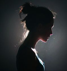 Shadowy Side Portrait; light in background, simple image that tells a story