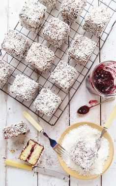 Cherry lamingtons - squares of vanilla sponge cake filled with jam and coated in chocolate and desiccated coconut - Domestic Gothess