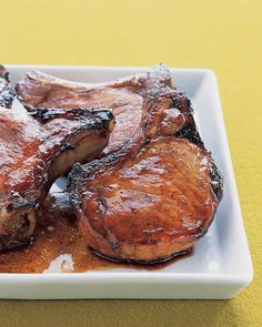 Marinated Pork Chops by marthastewart via buzzfed: MARINADE: soy sauce + hoisin sauce + garlic + honey + sugar + 1 to 24 hours. I used Sriracha sauce instead of hoisin sauce. Honey Pork Chops, Marinated Pork Chops, Asian Pork Chops, Pork Loin, Pork Chop Recipes, Meat Recipes, Cooking Recipes, Garlic Recipes, Carne Asada
