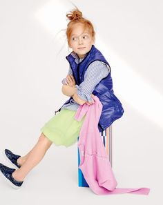 J.Crew girls' quilted puffer vest, button-down shirt in stripe, tulle skirt, cashmere cardigan sweater and slip-on sneakers in glitter. To pre-order, call 800 261 7422 or email verypersonalstylist@jcrew.com.