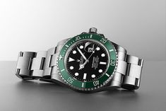 With a new green ceramic bezel, black dial, larger case and redesigned oyster strap, the new Rolex Submariner 126610LV offers everything your heart desires. Believe us when we say: this is a watch for a lifetime. Buy Rolex, Rolex Models, Luxury Watch Brands, New Green, Rolex Submariner, Oysters, Rolex Watches, Larger, Arm