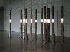 'Arboreal fragments' (2004) - cast glass, found wood, lights 240cm ht Ione Thorkelsson Photo: Robert Barnett www.thorkelsson.com