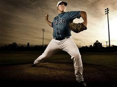 Awesome action pose and impressive photography for this senior portrait for a baseball player