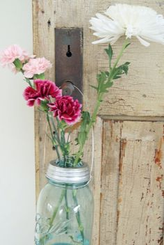 A beautiful combination of so many things I love: jars, flowers, antique keyhole, and a flower frog...