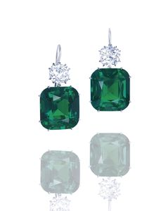 A PAIR OF EMERALD AND DIAMOND EAR PENDANTS. Each set with a cushion-shaped emerald weighing 25.38 and 23.12 carats, surmounted by a cushion-shaped diamond weighing 3.04 and 3.04 carats, mounted in platinum, 3.6 cm long. Price Realized USD 4,055,052 // Estimate USD 1,998,500 - USD 3,223,388. Gübelin / AGL / the emeralds are of Colombia origin, with no indications of clarity enhancement. GIA / both diamonds - G/VS2 [C. HK 29 NOV. 2011] #Christies #Emerald #NoTreatment