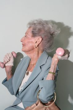 Ruth,100, lifting weights, in a favorite pair of gloves...weight lifting in little lace gloves is pretty excellent.