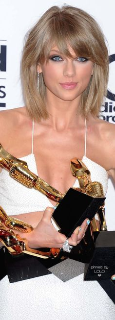 Taylor Swift with her eight billboard music awards 2015- long live that look on your face- Romeo save me I can't carry these alone