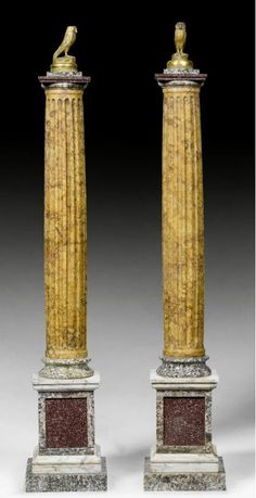 """PAIR OF SMALL TABLE COLUMNS """"AU HIBOU"""",Baroque, Rome, 18th/19th century. """"Giallo di Siena"""", """"Verde Antico"""" and various other marble types and porphyry. With later bronze owl. H 77 cm."""