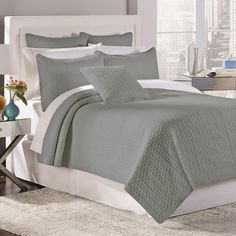 Accentuate bright pillows in the guest room or add a touch of texture to the master suite with this lovely quilt set, showcasing a stitched geometric design....