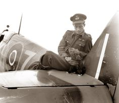 The is Pilot Officer Willie Lane. Lane died shortly after the photo was taken. Since Lane was shot down on 15 May 1943 (and was reported killed on 8 June 1943) we can assume the photo was taken during the second week of May 1943.The look of gentleness on the young pilot's face tells us how much comfort these dogs were capable of giving these stressed young men