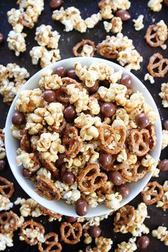 Peanut Butter Pretzel Popcorn Recipe on twopeasandtheirpod.com Love this sweet and salty popcorn! It's perfect for parties, movie night, game day, or every day snacking!