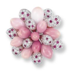DESIGNED AS A FLOWERHEAD, THE BRILLIANT-CUT DIAMOND PETALS ACCENTED BY CIRCULAR-CUT RUBIES, INTERSPERSED BY CONCH PEARLS MEASURING APPROXIMATELY 5.7 – 8.0 MM, MOUNTED IN PLATINUM, 3.5 CM LONG