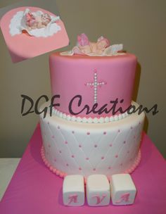 Baptism cake in fuchsia with fondant baby as a topper wearing a white diaper and little ruffle pink skirt.  The bottom Tier is covered in white fondant with a quilt design with little pink pearls.