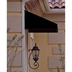 Awntech�4-ft 4-1/2-in Wide x 2-ft 6-in Projection Black Slope Low Eave Window/Door Awning. Over front window above bench.