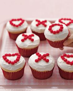 Valentines Day X's and O's Cupcakes! Happy times with kids call for cheerful cupcakes. Easier to serve than cake, cupcakes require no slicing, no plates, and no forks -- and every child gets her fair share of icing. Valentines Day Food, Valentine Day Cupcakes, Holiday Cupcakes, Valentine Treats, Valentine Day Crafts, Holiday Treats, Holiday Recipes, Heart Cupcakes, Sweet Cupcakes