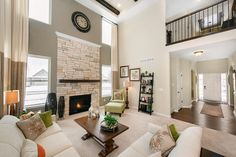 A stacked stone fireplace defines this soaring great room. The Forest plan, a new home built by Lombardo Homes at Majestic Lakes. Ypsilanti, MI.