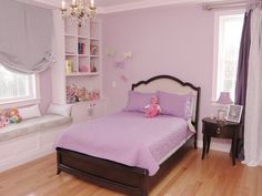 Transitional furniture paired with a playful lilac color on the walls and bedding defines youthful style in this girl's bedroom