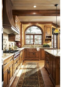 Gorgeous #kitchen! All this woodwork would make the perfect kitchen space for your getaway home in the mountains!