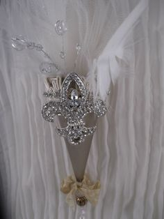 Handmade Parisian Christmas Ornament to adorn your tree or hang in a special spot. In champagne, light beige, cream & ivory. Champagne cone ivory tulle, ivory feathers, crystal accents, cream trim, crystal rhinestone chain, silver brooch, light beige ribbon, and 5 beads on bottom