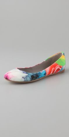 She loves flats and bright colors.  Plus, these ones will go with just about any brightly colored dress she pulls out of her closet.  I almost dare her to find something that doesn't match.  I said almost.