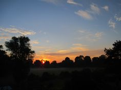 Sunrise at 5.25am seen from the bedroom window of our Shropshire home on the 16th July 2015. The morning mist still lies across the water meadows beyond the river