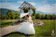 Outdoor bridal portrait at Bristol Harbour - bride with veil blowing in the wind in front of view of Canandaigua Lake photographed by Katie Finnerty Photography http://www.katiefinnertyphotography.com