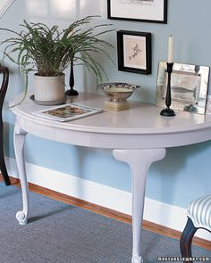 Transform an old drop-leaf table into a console. It's a great accent for any room and a great place to keep your keys and other daily items. See how to make it with instructions from Martha Stewart.