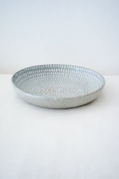 Malinda Reich no. 773 - A wide bowl with intricate indentations, featuring milky blue and grey glazes, with unglazed areas.Friend and neighbor Malinda Reich's wheel-thrown serving piec - from QUITOKEETO.com