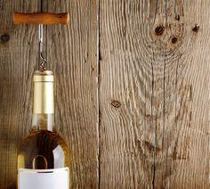 Wine bottle on old wood by windu on @creativemarket