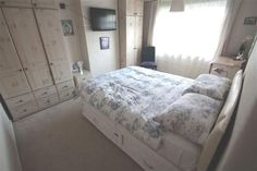 Check out this property for sale on #Zoopla - King Size White Leather bed and pine wardrobes or fitted wardrobes are good - plain white or pathchwork quilt cover with Marilyn Monroe pictures - Art Dec on walls - so neutral colour throughout