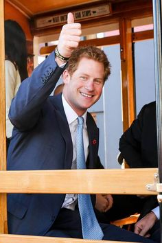 Thumbs up Prince Harry takes the tram Photo (C) Getty Images
