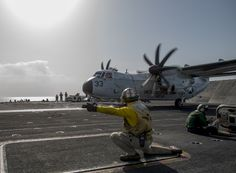 ARABIAN GULF (March 3, 2015) Lt. Bryce Fitzgerald signals to launch an C-2A Greyhound from the Providers of Fleet Logistics Support Squadron (VRC) 30 during flight operations aboard the aircraft carrier USS Carl Vinson (CVN 70). Carl Vinson is deployed to the area supporting maritime security operations, strike operations in Iraq and Syria as directed, and theater security cooperation efforts in the 5th Fleet area of responsibility. (US Navy photo)