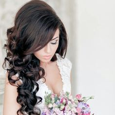 Soft curls, pinned half up, veil? Good with the plunging V dress.