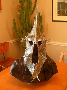 This is a cake. A CAKE! OH HECK YES! IT IS THE LORD OF THE NAZGUL, HEAD CAKE-WRAITH. FEAR HIM. NO MAN CAN KILL HIM. BUT YOU CAN BE SURE AS HECK SOMEONE COULD EAT HIS TASTY HELMET :D