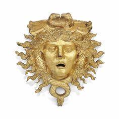 A large gilt-bronze mask of Hermes