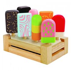 This ice cream bar features eight different colourful ice cream bars arranged in an ice cream tray.