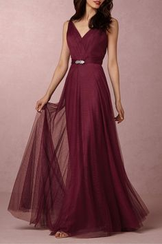 $250 BUY NOW Cranberry is the ultimate winter color. Layers of tulle create fluid movement, which will have a floating effect when your squad walks down the aisle. The best part is that the straps are convertible (four different options!), so your girls can decide what look they feel most comfortable in.