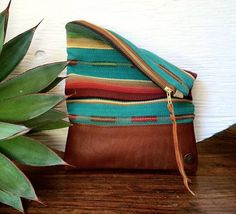 I love these handbags!! Handmade Genuine Leather Clutch with Navajo by indigosoulcompany
