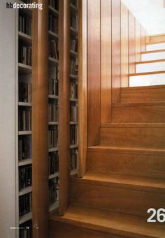 CD and DVD storage in the wall of a staircase.  What a clever use of space.  The cupboards would nest neatly between the studs.