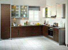 L-shape with window over sink, frosted glass overheads and similar space to work with